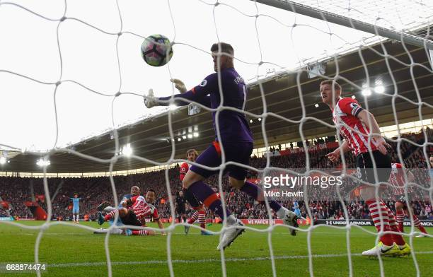 Vincent Kompany of Manchester City scores his sides first goal past Fraser Forster of Southampton during the Premier League match between Southampton...