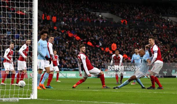 Vincent Kompany of Manchester City scores his sides second goal during the Carabao Cup Final between Arsenal and Manchester City at Wembley Stadium...