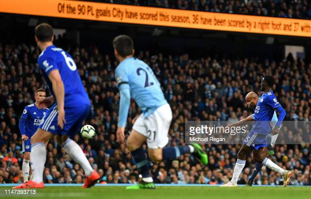 Vincent Kompany of Manchester City scores his team's first goal during the Premier League match between Manchester City and Leicester City at Etihad...