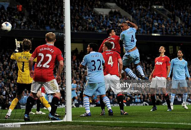 Vincent Kompany of Manchester City scores the opening goal during the Barclays Premier League match between Manchester City and Manchester United at...