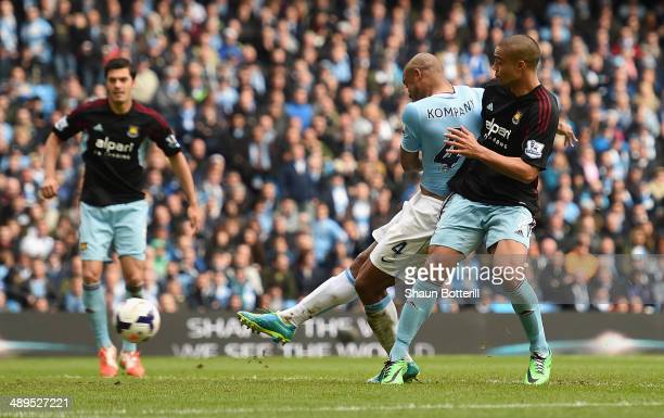 Vincent Kompany of Manchester City scores the second goal during the Barclays Premier League match between Manchester City and West Ham United at the...
