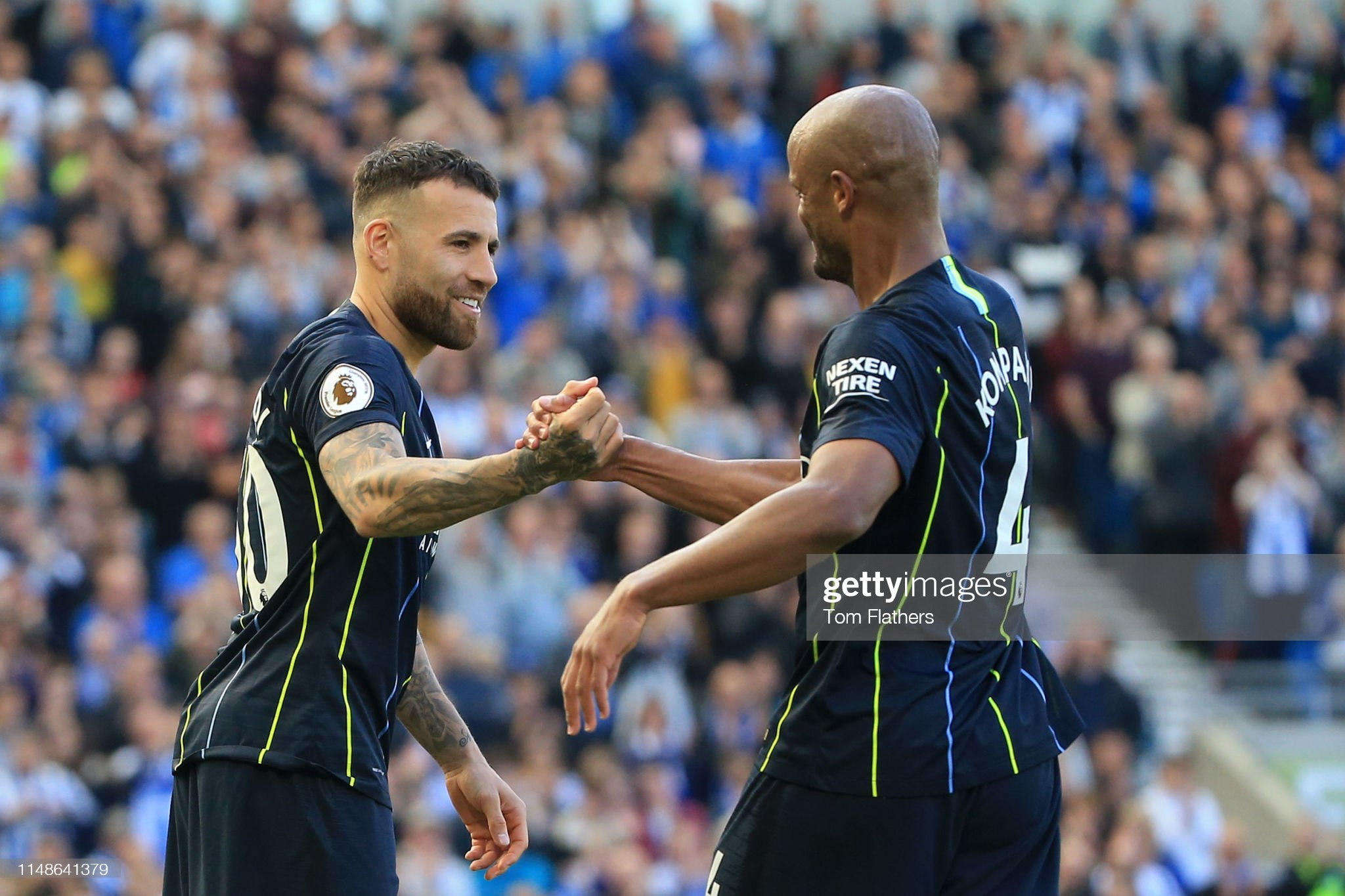 https://media.gettyimages.com/photos/vincent-kompany-of-manchester-city-shakes-hands-with-nicolas-otamendi-picture-id1148641379?s=2048x2048
