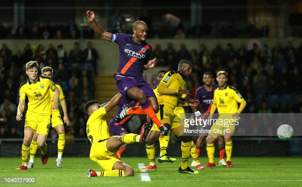 Vincent Kompany of Manchester City shoots during the Carabao Cup Third Round match between Oxford United and Manchester City at Kassam Stadium on...