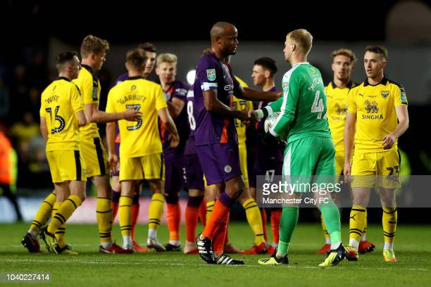 Vincent Kompany of Manchester City speaks with Jonathan Mitchell of Oxford United following Manchester City's victory in the Carabao Cup Third Round...