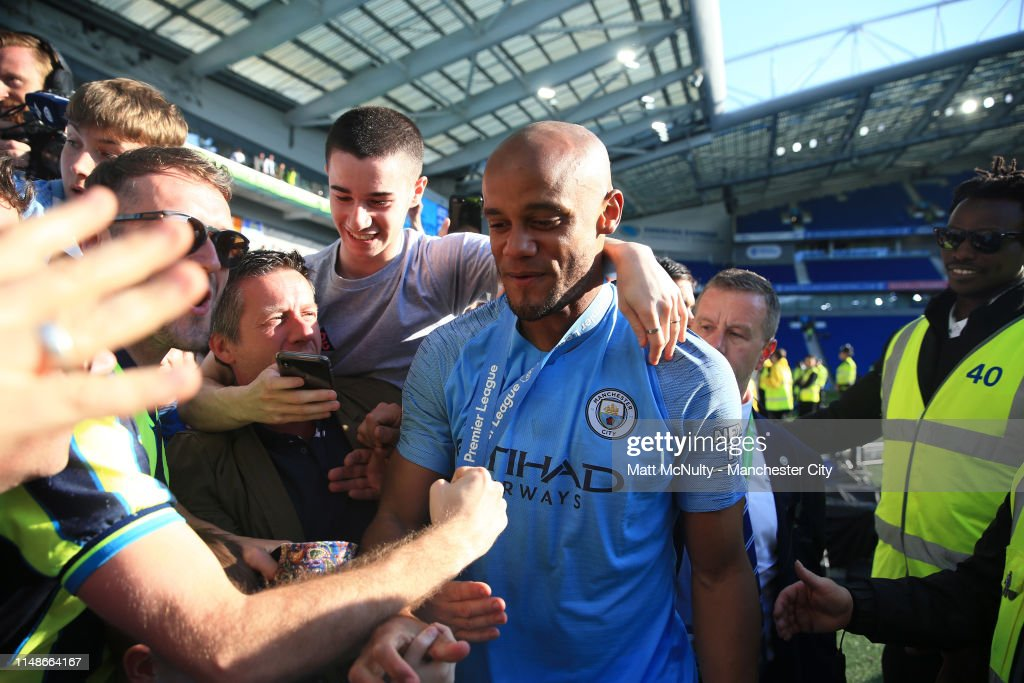 Vincent Kompany of Manchester City stops for photographs with fans