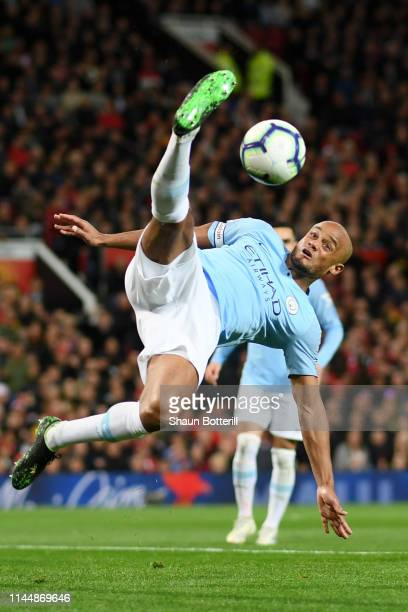 Vincent Kompany of Manchester City stretches for the ball during the Premier League match between Manchester United and Manchester City at Old...