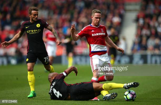 Vincent Kompany of Manchester City tackles Adam Forshaw of Middlesbrough during the Premier League match between Middlesbrough and Manchester City at...