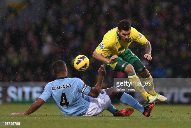 Vincent Kompany of Manchester City tackles Bradley Johnson of Norwich City during the Barclays Premier League match between Norwich City and...