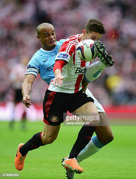 Vincent Kompany of Manchester City tackles Fabio Borini of Sunderland during the Capital One Cup Final between Manchester City and Sunderland at...