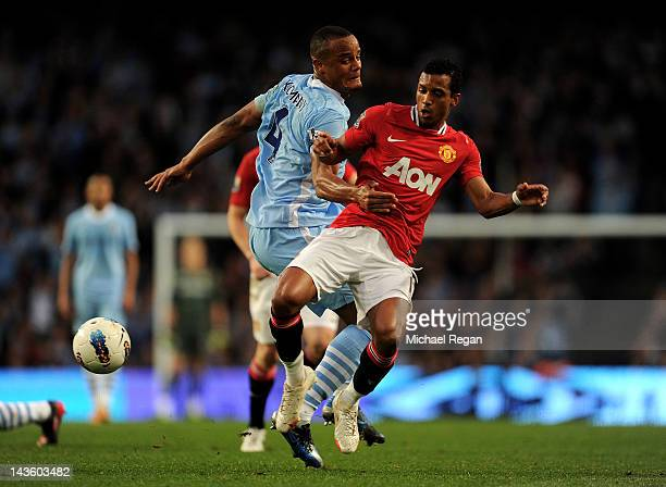 Vincent Kompany of Manchester City tangles with Nani of Manchester United during the Barclays Premier League match between Manchester City and...
