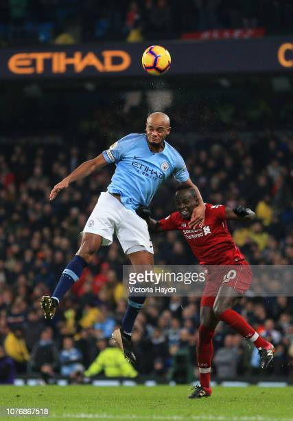 Vincent Kompany of Manchester City wins a header over Sadio Mane of Liverpool during the Premier League match between Manchester City and Liverpool...
