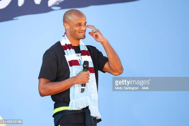 Vincent Kompany of Manchester City wipes a tear during the Manchester City trophy parade in Manchester on May 20 2019 in Manchester England
