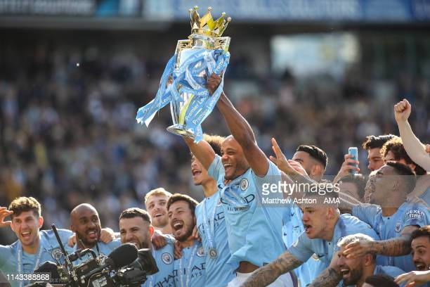 Vincent Kompany of Manchester City with the premier league trophy during the celebrations of becoming 2019 Champions after the Premier League match...