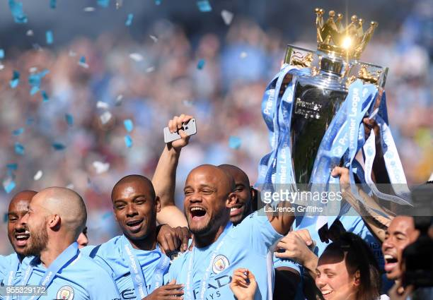 Vincent Kompany of Mancheter City lifts The Premier League Trophy after the Premier League match between Manchester City and Huddersfield Town at...