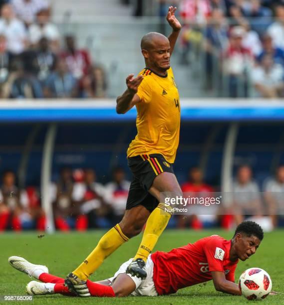Vincent Kompany of the Belgium national football team and Marcus Rashford of the England national football team vie for the ball during the 2018 FIFA...