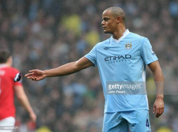 Vincent Kompany throws the captain's armband to a teammate after being sent off during the FA Cup Third Round match between Manchester City and...