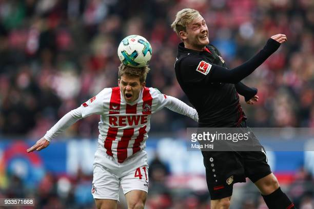 Vincent Koziello of 1FC Koeln and Julian Brandt of Bayer Leverkusen during the Bundesliga match between 1 FC Koeln and Bayer 04 Leverkusen at...