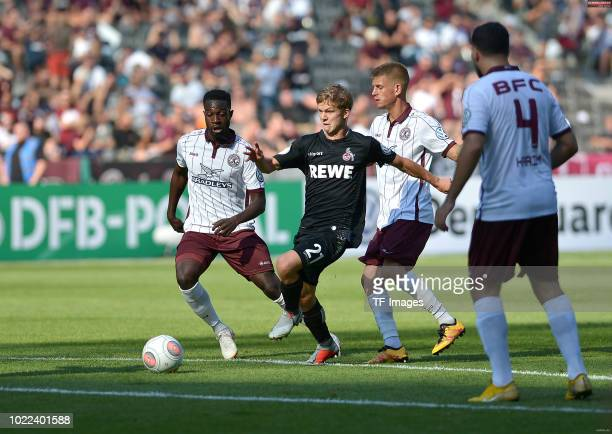 Vincent Koziello of FC Koeln and Otis Breustedt of BFC Dynamo battle for the ball during the DFB Cup first round match between BFC Dynamo and 1 FC...