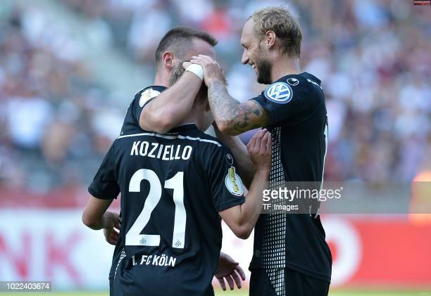 Vincent Koziello of FC Koeln celebrates after scoring his team`s sixth goal with Christian Clemens of FC Koeln and Marcel Risse of FC Koeln during...