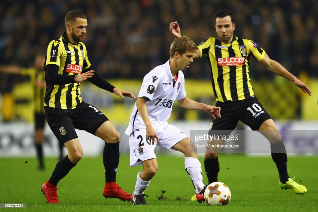 Vincent Koziello of OGC Nice battles for the ball with Luc Castaignos and Thomas Bruns of Vitesse Arnhem during the UEFA Europa League group K match between Vitesse and OGC Nice at on December 7, 2017 in Arnhem, Netherlands.