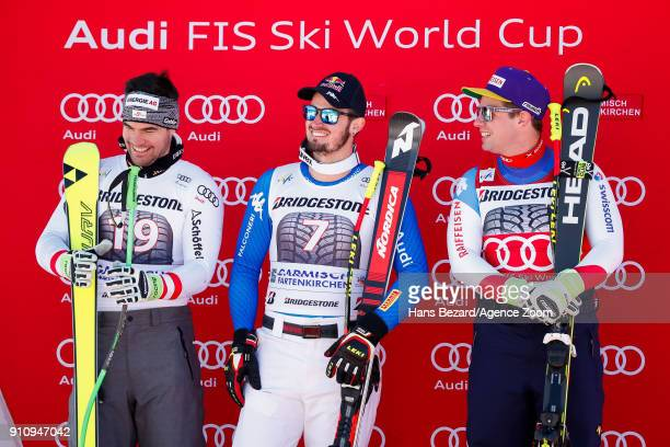 Vincent Kriechmayr of Austria takes 2nd place Dominik Paris of Italy takes 3rd place Beat Feuz of Switzerland takes 1st place during the Audi FIS...