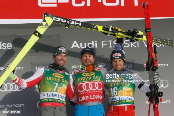 Vincent Kriechmayr of Austria takes 2nd place, Kjetil Jansrud of Norway takes 1st place, Mauro Caviezel of Switzerland takes 3rd place during the...