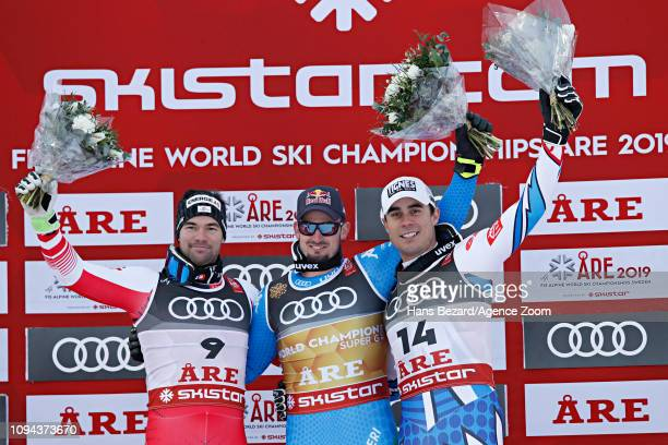 Vincent Kriechmayr of Austria wins the silver medal Dominik Paris of Italy wins the gold medal Johan Clarey of France wins the silver medal during...
