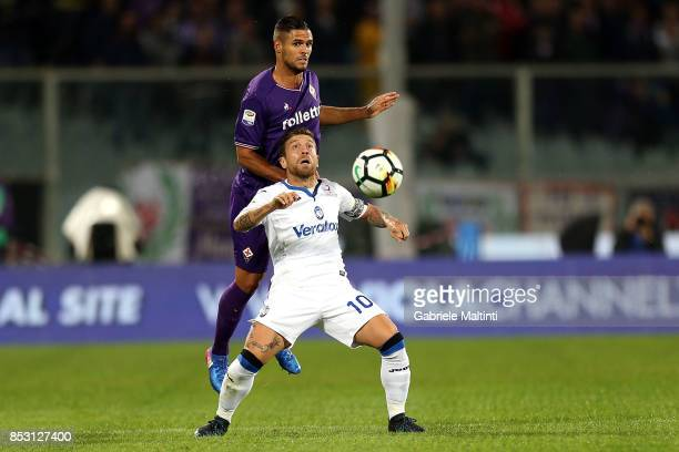 Vincent Laurini of ACF Fiorentina battles for the ball with Alejandro Gomez of Atalanta BC during the Serie A match between FC Crotone and Benevento...