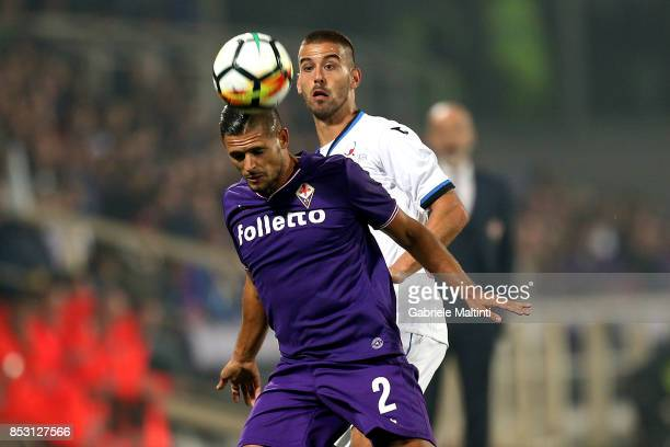 Vincent Laurini of ACF Fiorentina battles for the ball with Leonardo Spinazzola of Atalanta BC during the Serie A match between FC Crotone and...