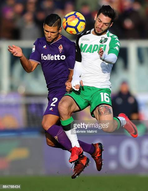 Vincent Laurini of ACF Fiorentina battles for the ball with Matteo Politano of US Sassuolo during the Serie A match between ACF Fiorentina and US...
