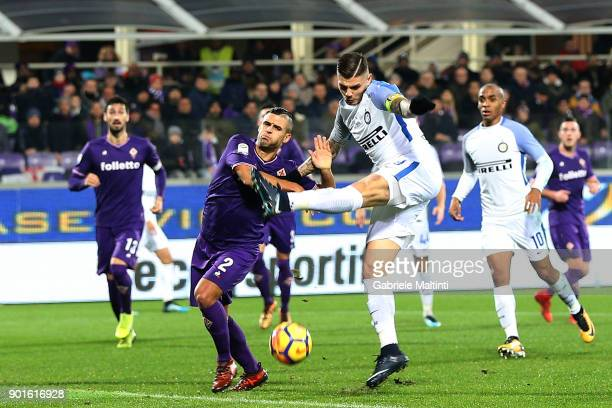 Vincent Laurini of ACF Fiorentina battles for the ball with Mauro Icardi of FC Internazionale during the serie A match between ACF Fiorentina and FC...