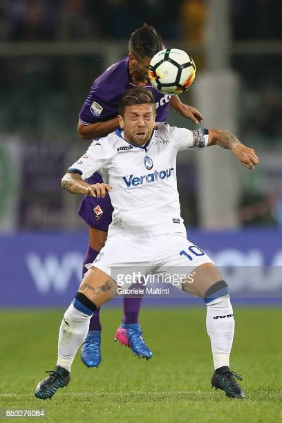 Vincent Laurini of ACF Fiorentina in action against Alejandro Gomez of Atalanta BC during the Serie A match between FC Crotone and Benevento Calcio...