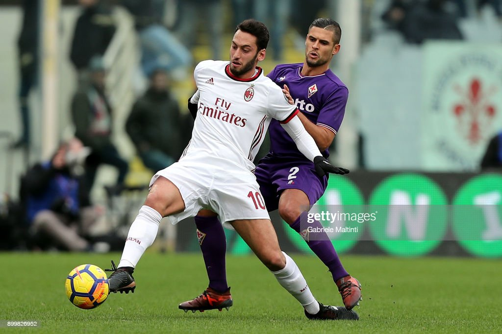 Vincent Laurini of ACF Fiorentina in action against Hakan Calhanoglu of AC Milan during the serie A match between ACF Fiorentina and AC Milan at Stadio Artemio Franchi on December 30, 2017 in Florence, Italy.