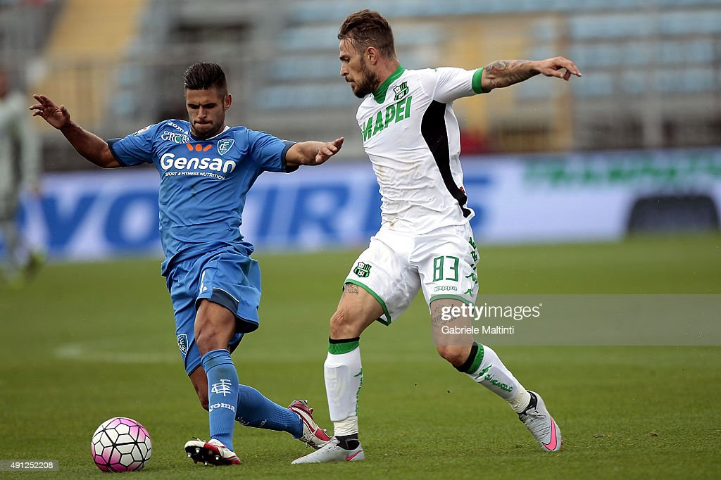 Vincent Laurini of Empoli FC battles for the ball with Federico Peluso of US Sassuolo Calcio during the Serie A match between Empoli FC and US Sassuolo Calcio at Stadio Carlo Castellani on October 4, 2015 in Empoli, Italy.
