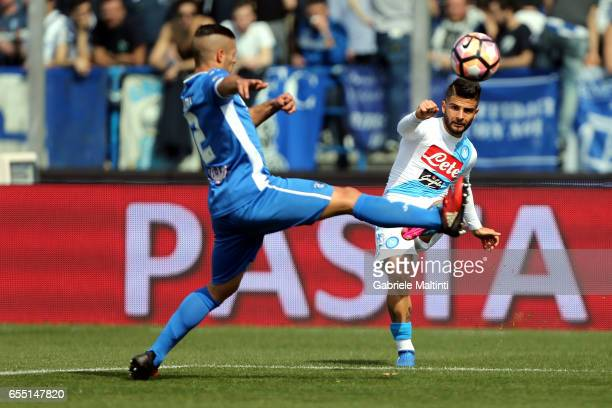 Vincent Laurini of Empoli Fc battles for the ball with Lorenzo Insigne of SSC Napoli during the Serie A match between Empoli FC and SSC Napoli at...
