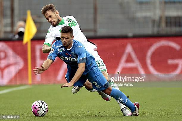 Vincent Laurini of Empoli FC in action against Antonio Floro Flores of US Sassuolo Calcio during the Serie A match between Empoli FC and US Sassuolo...