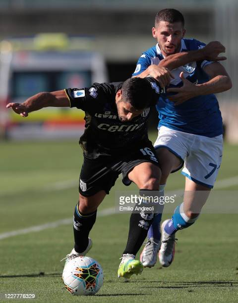Vincent Laurini of Parma Calcio competes for the ball with Nikolas Spalek of Brescia Calcio during the Serie A match between Brescia Calcio and Parma...