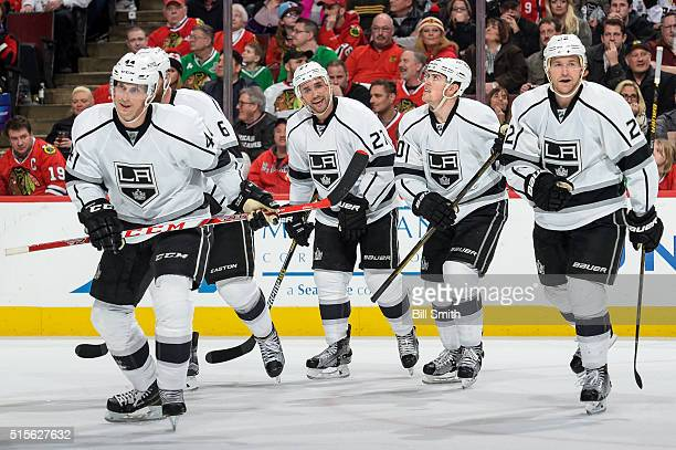Vincent Lecavalier Alec Martinez Tanner Pearson and Trevor Lewis of the Los Angeles Kings skate toward the bench after Lecavalier scored in the...