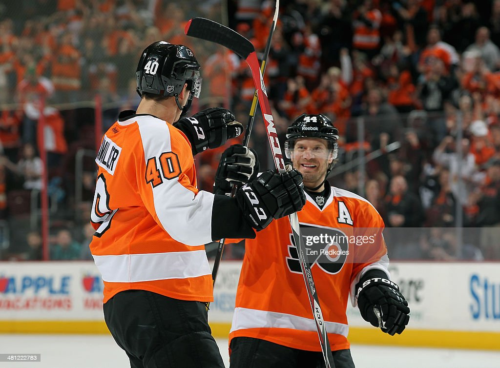 Vincent Lecavalier #40 and Kimmo Timonen #44 of the Philadelphia Flyers celebrate Lecavalier's first period power-play goal against the Toronto Maple Leafs on March 28, 2014 at the Wells Fargo Center in Philadelphia, Pennsylvania.