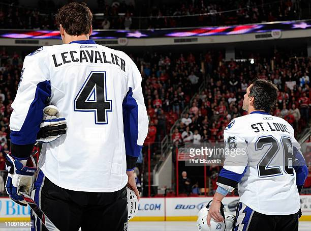 Vincent Lecavalier and Martin St Louis of the Tampa Bay Lightning are pictured before the opening faceoff of an NHL game against the Carolina...