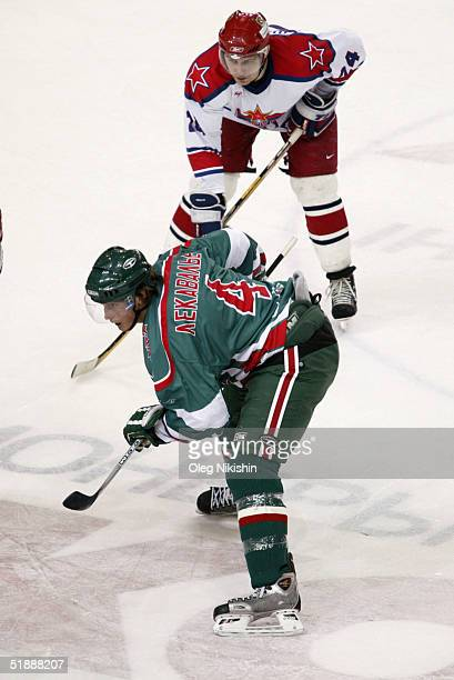 Vincent Lecavalier of AkBars Kazan in action against Alexander Frolov of CSKA Moscow December 22 2004 at CSKA Ice Arena in Moscow Russia AkBars Kazan...