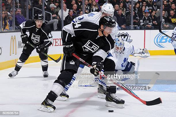Vincent Lecavalier of the Los Angeles Kings controls the puck against Dion Phaneuf and James Reimer of the Toronto Maple Leafs on January 7 2016 at...