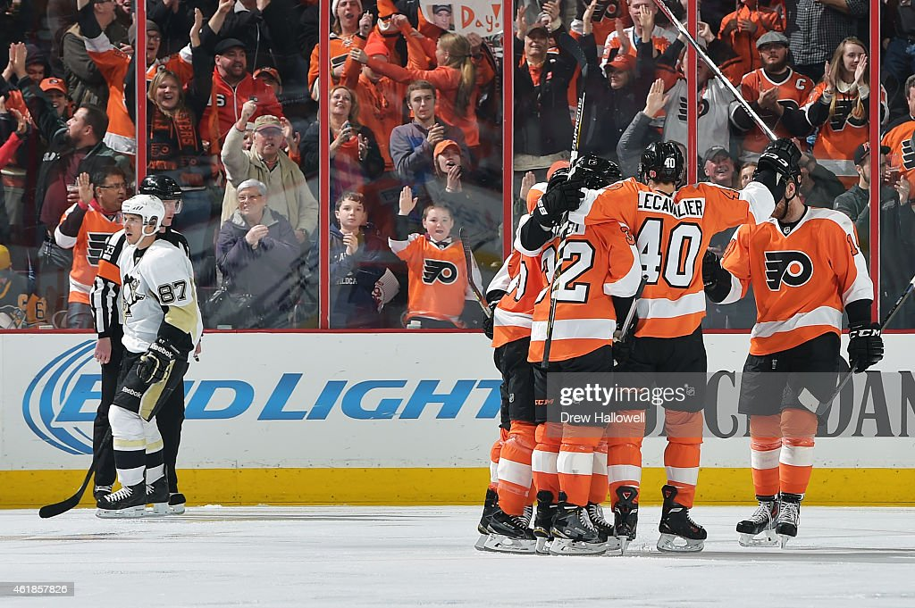 Vincent Lecavalier #40 of the Philadelphia Flyers and teammates celebrate a third period goal as Sidney Crosby #87 of the Pittsburgh Penguins skates away at the Wells Fargo Center on January 20, 2015 in Philadelphia, Pennsylvania. The Flyers won 3-2 in overtime.