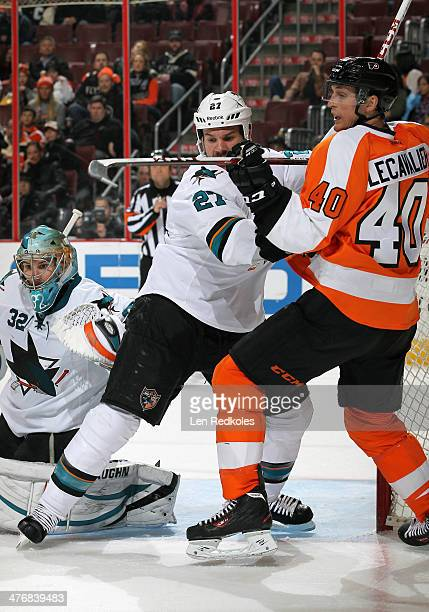 Vincent Lecavalier of the Philadelphia Flyers battles against Scott Hannan and Alex Stalock of the San Jose Sharks on February 27 2014 at the Wells...