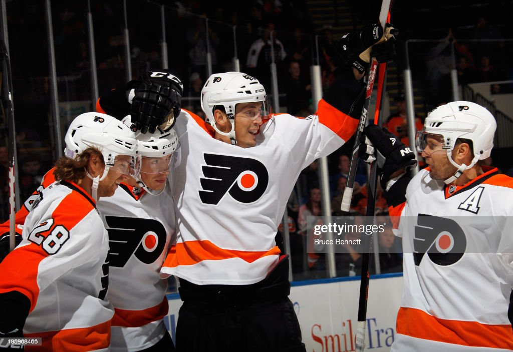 Vincent Lecavalier #40 of the Philadelphia Flyers celebrates his second goal at 18:13 of the first period against the New York Islanders at the Nassau Veterans Memorial Coliseum on October 26, 2013 in Uniondale, New York.