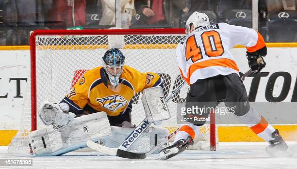 Vincent Lecavalier of the Philadelphia Flyers scores the winning shootout goal against Marek Mazanec of the Nashville Predators at Bridgestone Arena...
