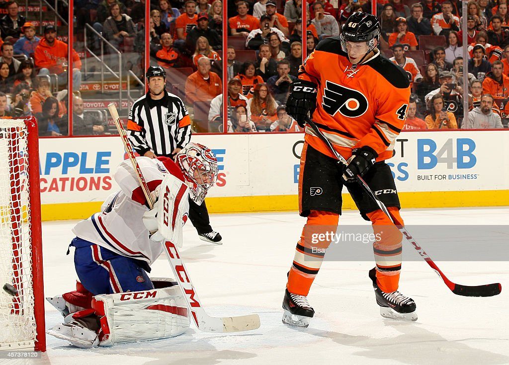 Vincent Lecavalier #40 of the Philadelphia Flyers takes a shot as Carey Price #31 of the Montreal Canadiens deflects in the second period on October 11, 2014 at the Wells Fargo Center in Philadelphia, Pennsylvania.