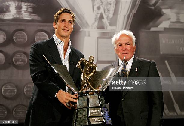 Vincent Lecavalier of the Tampa Bay and Henri Richard pose with the Maurice Rocket Richard Trophy during the NHL Awards Luncheon on June 2 2007 at...