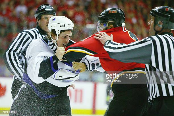 Vincent Lecavalier of the Tampa Bay Lightning exchanges punches with Jarome Iginla of the Calgary Flames during the first period in game three of the...