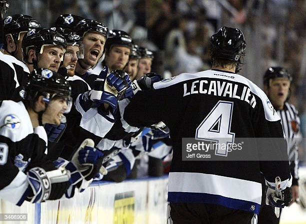 Vincent Lecavalier of the Tampa Bay Lightning gets congratulations from the bench after scoring his second goal of the game during Game two of the...